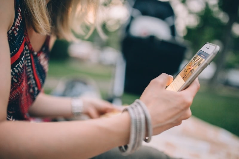 Image of woman looking at an image on her phone